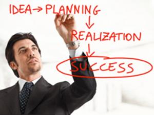 From Secret Entrepreneur to Full-Time Freelancer - image - man writing on board in red pen