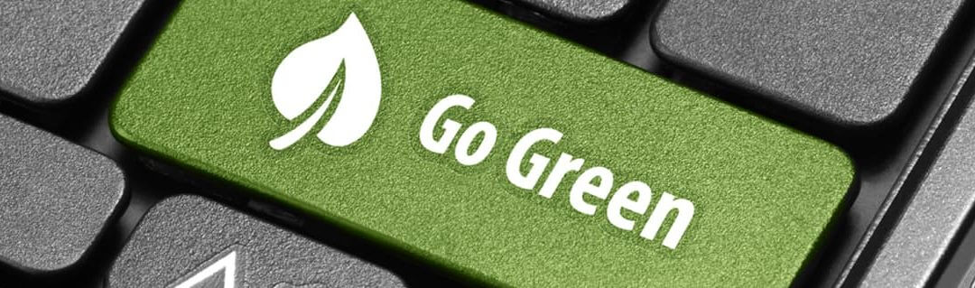 Go green economical keyboard button on a laptop
