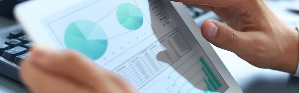 Business Plan Guide: Researching Your Market & Getting Funding - image - man holding tablet with graphs