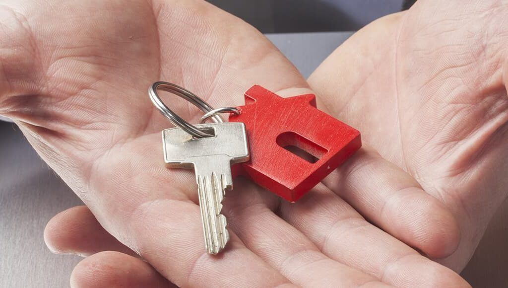 Buy To Let Tax Changes - image - hands holding keys with house keyring