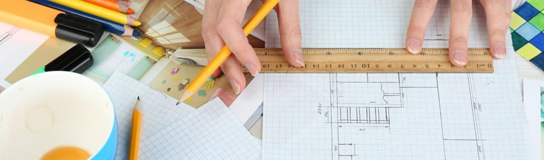 Designers, Toys and Greeting Cards- Entrepreneurial Artists - image - hands drawing house layout on square paper with pencil and ruler