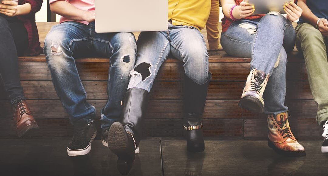 Founder Of Crowdfund Campus On Becoming Your Own Boss - image - teenagers sitting on a wall with legs dangling