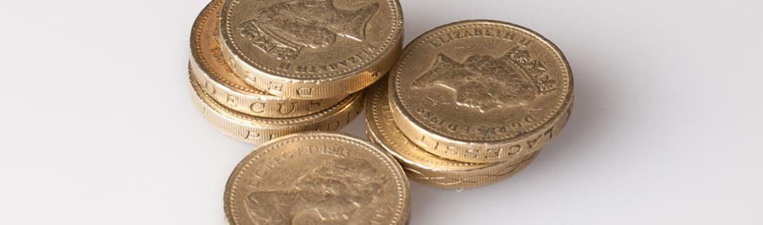 Guide to Managing Cash Flow - image - stacks of pound coins