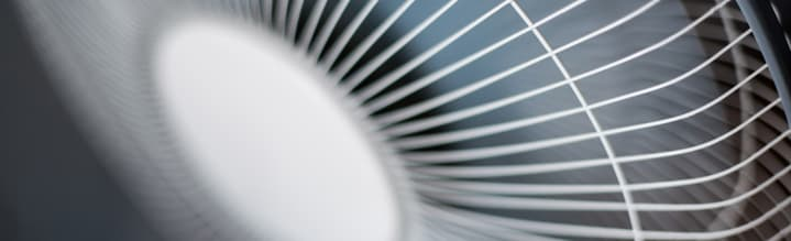 How To Improve The Air Quality Of Your Workplace image - cross section of a white metal electric fan