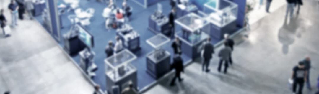 How to make the most of trade shows - Aerial view of a busy trade show/exhibition