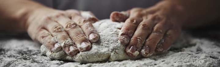 How to Start a Cake Baking Business image - man's hands kneading dough