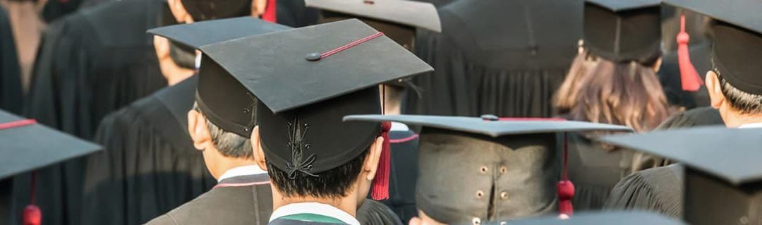How University Can Open Your Mind to Enterprise - image - backs of university students heads wearing graduation caps
