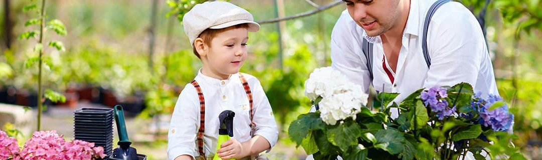 Young child watching a small business owner work in a garden center
