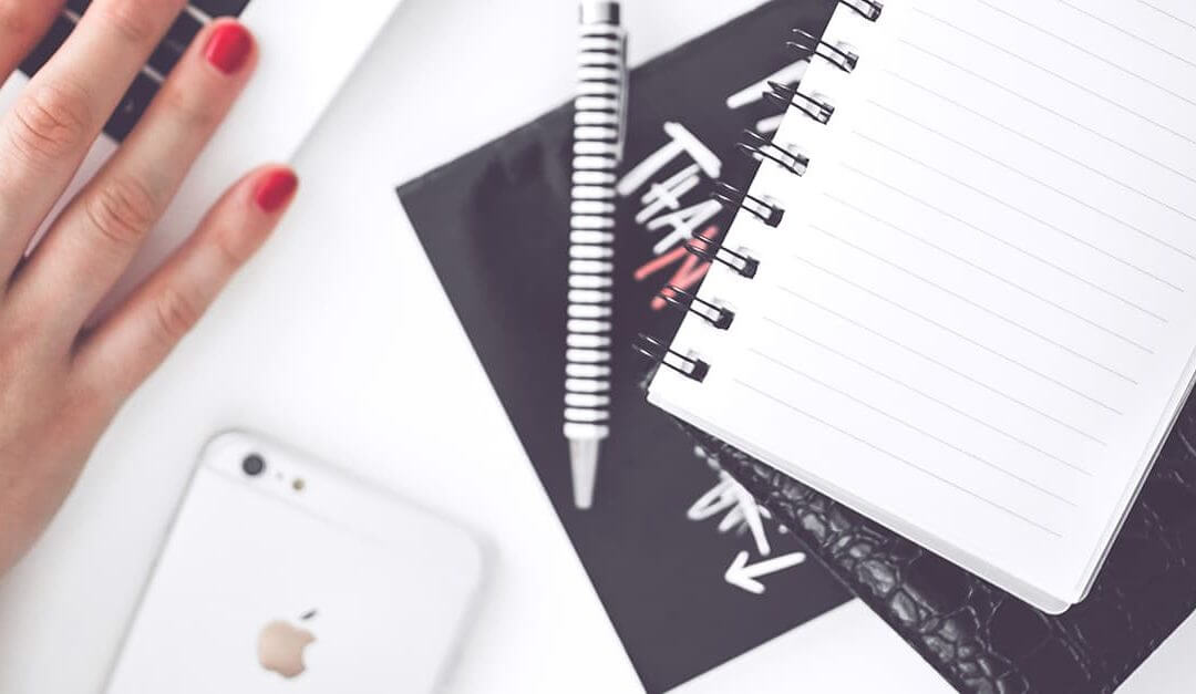 The Most Profitable Types of Small Business to Start Up - image - Desk with phone pen and notebooks