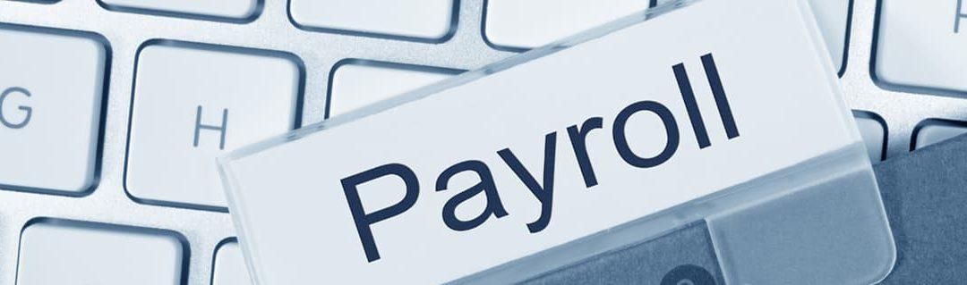 Payroll label ontop of a kevboard