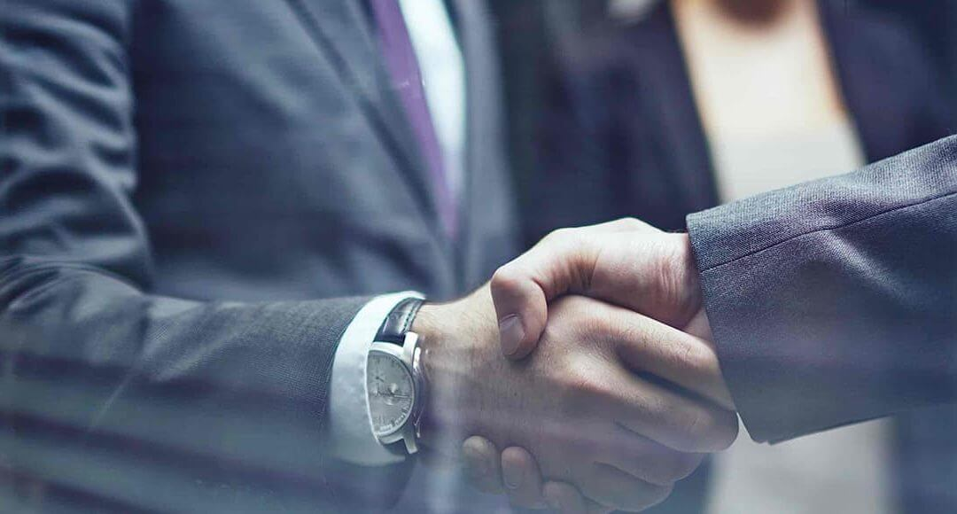 Business men wearing suits conducting a handshake
