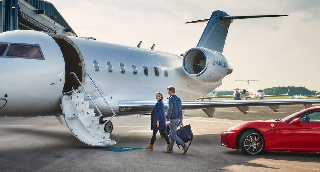 The Startup Journey Of Stratajet CEO And Founder Jonny Nicol image - couple on runway about to walk up steps to an aircraft