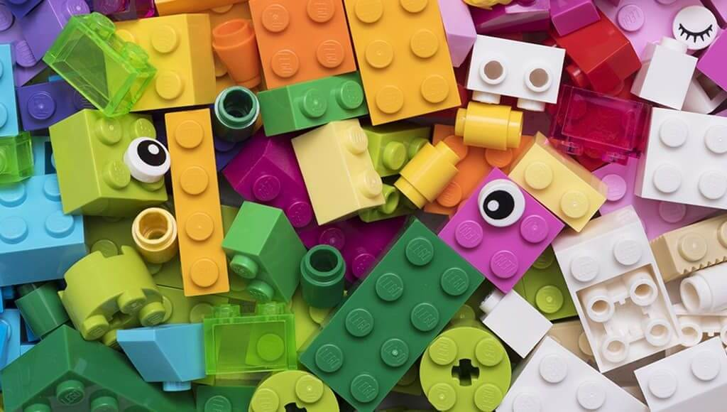 Brick By Brick: What Small Businesses Can Learn From Lego image - different coloured Lego pieces