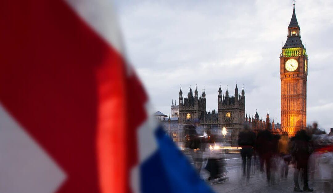 Which Political Party is Best for Small Businesses image - houses of parliament and Big Ben tower in the distance behind a union flag