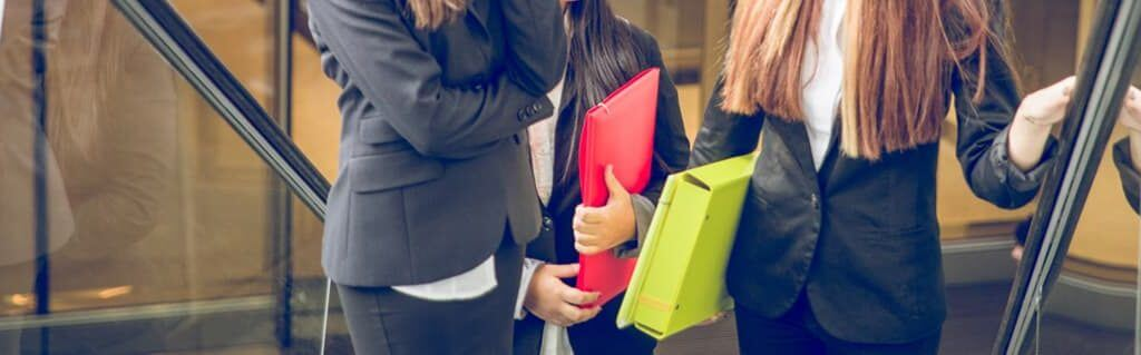 Join the UK's Women Starting their Own Businesses - image - women in suits holding files