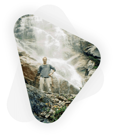 client business owner with waterfall in background